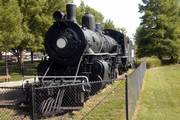 The old steam locomotive in Watson Park, south of Sixth Street between Kentucky and Tennessee streets, is now enclosed by a fence. Safety concerns prompted the city to put up fencing to keep visitors from climbing on the train.