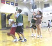 Nicole Humphrey, from left, Nick Pellett, Nicholas Shaheed and Erika Sander play a game of three-on-three at the Free State High basketball camp. Only three of the 60 camp participants were girls. The camp consisted of seventh-through 12th-grade boys and girls and ran all of June and July.