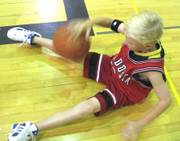 Alex Goertz dribbles the basketball as part of a drill at the Lawrence High basketball camp.  The camp ran from July 17-21 to help participants improve basic skills.