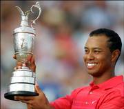 Tiger Woods holds the british open trophy - known as the claret jug - following his victory at Royal Liverpool Golf Course in Hoylake, Eng;land. Woods' shot-making skills could mean sustained success in the lone non-U.S. major.