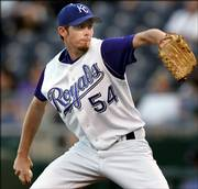 Kansas City pitcher Mike MacDougal delivers in this file photo from Sept. 20, 2005. The Royals traded MacDougal to the White Sox for two minor-league pitchers.