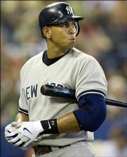 New York's Alex Rodriguez reacts after striking out during the Yankees' game Saturday against Toronto. A-Rod has been struggling with stick and glove, just when the Yankees need him most.