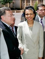 Lebanon's Prime Minister Fuad Saniora greets U.S. Secretary of State Condoleezza Rice as she arrives Monday in Beirut, Lebanon.