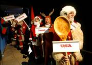 Santas from the United States, Japan, Norway and Sweden line up backstage before making their entrance at a convention in Copenhagen, Denmark. Six months ahead of Christmas, more than 150 Santas gathered in Denmark for the annual World Santa Claus Congress.