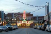 """Downtown Manhattan, known as """"Aggieville,"""" thrives during the school year with restaurants, bars and businesses that cater to Kansas State University students. Town-and-gown relationships can be tricky in university towns, with both competing interests and dependency on cooperation."""