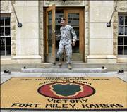 Maj. Gen. Dennis Hardy exits the headquarters building Friday at Fort Riley. After a three-year stint as post commander, Hardy will hand over command of the base to Brig. Gen. Carter Ham on Tuesday.