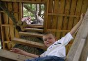 The treehouse of Tabetha Faith, 6, left, and her brother Raymond Faith, 7, features a trapdoor entrance and a pulley system to hoist items into the house. They live with their mother, Sarah Faith, in south Lawrence.