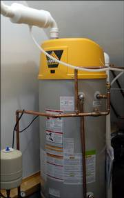 The home is heated by hot water tubes running through the floors and controlled by this high-efficiency water heater.