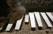 The smallest of the 31 simple plywood coffins, center, containing 1-day-old girl Sawsan Tajeldin, can be seen as a bulldozer pours soil to bury Lebanese victims Saturday in a mass grave at the southern port city of Tyre, Lebanon. Sawsan was killed along with her mother when the car in which they were fleeing was hit by an Israeli warplane missile strike.