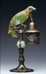 This unusual bronze parrot-shaped table lamp holds a lantern with an electric light bulb inside. The 15 1/4-inch lamp attracted a buyer who spent $518 for it at a James Julia auction in Fairfield, Maine.