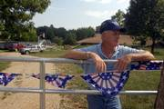 John Welborn stands at the front gate of his rural Jefferson County home, which has been burglarized 13 times since the late 1970s. Prosecutors say his home was the first to be burglarized in a four-county 2005 crime spree that included the killing of Clarence David Boose, 77, of rural Lecompton. Welborn says he has yet to see any restitution ordered for previous burglaries, and doesn't expect any for the latest incident.