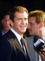 "Mel Gibson is under fire for comments he made early Friday when he was arrested for suspicion of driving under the influence. Gibson is pictured above in February 2002 arriving for the Los Angeles premiere of his film ""We Were Soldiers."""