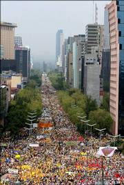 Thousands of protesters march on Mexico City's Reforma Avenue in support of Mexican presidential candidate Andres Manuel Lopez Obrador. The rally Sunday was called to demand a ballot-by-ballot recount of the July 2 elections.