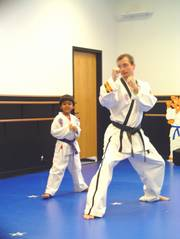 Tiny Tiger Hirsh Guha tests for his belt promotion with an instructor on Thursday.