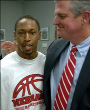 Nebraska athletic director Steve Pederson, right, met with senior guard Charles Richardson on Tuesday at a news conference discussing the resignation of coach Barry Collier. Pederson assured Richardson he'd do his best to find the best available candidate by the start of school.