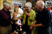 Kansas Insurance Commissioner Sandy Praeger, a Lawrence Republican, takes a telephone call with results from the polls Tuesday night during her re-election party at Mass. Street Deli. Praeger defeated challenger Eric Carter, of Overland Park, winning 59 percent of the vote. To Praeger's left is former Kansas State Sen. Dick Bond and right is former Kansas Atty. Gen. Bob Stephan, her campaign chairman.