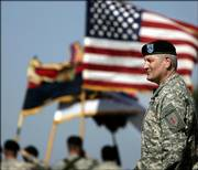 Maj. Gen. Carter Ham watches soldiers march past during a change of command ceremony at Fort Riley. Tuesday's ceremony marked the return of the 1st Infantry Division headquarters to Kansas after 10 years in Germany.