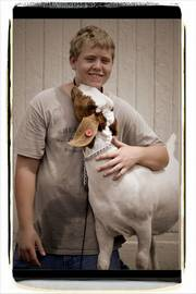 Quinton Keen, 14, of Baldwin, and his goat, Merv.