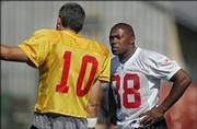 Chiefs running back Michael Bennett, right, listens to quarterback Trent Green. Bennett practiced with the Chiefs for the first time Thursday afternoon in River Falls, Wis.