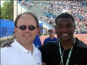 "Michael Stuart and elite sprinter Justin Gatlin are pictured at the Kansas Relays in April. Stuart, who adjusted Gatlin&squot;s back during the Relays, says he finds the scandal surrounding Gatlin ""disenchanting."""