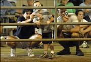 Amy Wintermantel, left, and nephew Caden Wintermantel, 3, and Scott Schwartz, all of Baldwin, catch a moment of the Beef Show with their camera phones Friday at the Douglas County Fair.