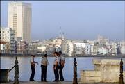 Cuban police officers patrol the Malecon, an oceanfront boardwalk in Havana, Cuba. Cuba's communist leadership launched a campaign Friday emphasizing the revolutionary roots of Fidel Castro's brother and designated successor, attempting to reassure Cubans that the regime remains stable after Fidel Castro's hospitalization.