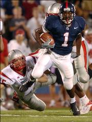 Kansas University's John Randle (1) escapes UNLV's Daniel Jones in this file photo from 2003. Randle, the Jayhawks' leading rusher in 2004, has transferred to Southern Illinois after his troubled times in Lawrence.
