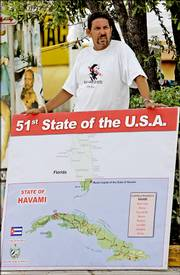 Cuban-American Lozano Marques holds a poster with a map of how he would like to see Cuba after Castro last week in Miami. These 700,000-plus refugees from Castro's oppressive regime helped transform nearly every facet of life in Florida. Today, a million Floridians identify themselves as Cuban.