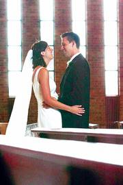 Anne and Mark Emert enjoy a quiet moment together on their wedding day.