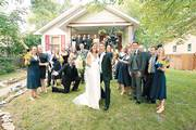 Anne and Mark Emert, who met while students in Kansas University's Law School, pose for a picture with their wedding party. They exchanged wedding vows June 10 at First Presbyterian Church in Lawrence.