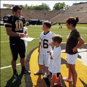 Missouri Quarterback Chase Daniel, left, signs autographs for, from right, Amanda Steckel, Barrett Smith and Cooper Smith. The public was welcome at the Tigers' picture day Sunday on Faurot Field in Columbia, Mo. Daniel likely will succeed Brad Smith as Mizzou's starting quarterback.