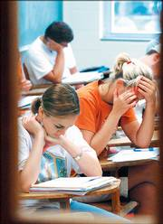 Student concentrate on their coursework during a summer session class at Fraser Hall.