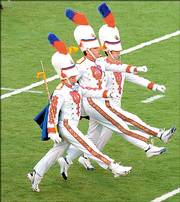 Kansas University Drum Corps Majors lead the band onto the field at Memorial Stadium for a Sept. 17, 2005, game. David Clemmer has been announced as the new director of athletic bands and assistant band director.