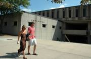 Students pass Wescoe Hall on the Kansas University campus. A study on possible health risks in the building found no significant hazards but did point to problems with airflow. Additional tests will be performed in upcoming weeks.