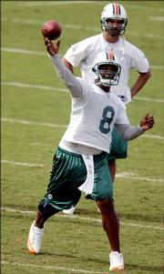 Miami Dolphins quarterback Daunte Culpepper throws during a minicamp earlier this summer. Culpepper, too, will start his team's exhibition opener when the Dolphins face the Jacksonville Jaguars on Saturday in Miami.