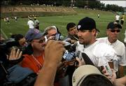 Pittsburgh Steelers' Ben Roethlisberger, center, talks with reporters as he leaves the practice field. The Steelers practiced Thursday in Latrobe, Pa. Coach Bill Cowher said Roethlisberger would start the Steelers' preseason opener Saturday in Phoenix.