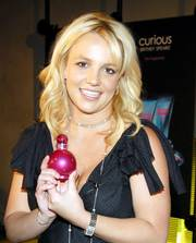 This file photo, originally supplied by Elizabeth Arden, shows Britney Spears promoting her new perfume, In Control, in New York. Since the launch of Curious in September 2004, 10 million bottles of Spears' fragrances have been sold. Her other fragrance is Fantasy.