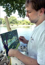 """Taylor Crowe paints recently at Capaha Park lagoon in Cape Girardeau, Mo. He will use the painting to open his presentation """"The View from Here: My Life with Autism,"""" at a conference Sept. 8 in Dallas."""