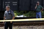 Lawrence police officers this afternoon investigate an accident along the railroad tracks in North Lawrence.