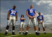 Kansas University linebackers, from left, Eric Washington, Mike Rivera, Joe Mortensen and James Holt hope to have a big impact on the revamped KU defense in 2006. Mortensen, a red-shirt sophomore, is competing with red-shirt freshman Jake Schermer for the right to replace Nick Reid at weak-side linebacker.