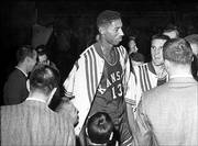 Kansas University's dustups with the NCAA date all the way back to when Wilt Chamberlain suited up for the Jayhawks in the 1950s. In 1960, the NCAA decided KU boosters were guilty of financing a car for Chamberlain and banned the Jayhawks from the 1961 and 1962 NCAA tournaments.