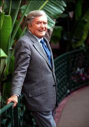 "Mike Douglas, who drew on his affable personality and singing talent during 21 years as a talk show host, died Friday on his 81st birthday. The host of ""The Mike Douglas Show"" is shown in 1999 at the Beverly Hills Hotel in Beverly Hills, Calif."