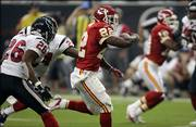 The Kansas City Chiefs' Dee Brown (22) runs past Houston Texans defenders Glenn Earl (26) and C.C. Brown (24) for a 12-yard touchdown. Brown scored the first of two Chiefs rushing touchdowns Saturday in Houston.