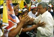 Presidential candidate Andres Manuel Lopez Obrador greets supporters Saturday in Tonala state of Chiapas, Mexico. The leftist candidate is demanding that vote results from nearly 5,000 polling places be thrown out.
