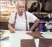 "Gary ""Cowboy"" Hollis demonstrates how each piece of leather is hand-cut for every project made at his shop in Tuscumbia, Mo. Hollis has made several hundred pairs of boots and countless custom-made saddles."