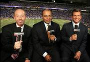 The new ESPN Monday Night Football television broadcast crew, from left Tony Kornheiser, Mike Tirico and Joe Theismann, pose for a photo before the Oakland-Minnesota preseason game. The new crew debuted Monday in Minneapolis.