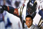 Junior Seau smiles during a news conference announcing his retirement from pro football. After 13 seasons, Seau announced his retirement in his hometown, San Diego, where he played for 13 seasons.