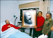 In this photo released by Cuba's Communist daily newspaper Granma, Fidel Castro, left, meets with Venezuela's President Hugo Chavez, center and interim President Raul Castro in Havana. Chavez visited on Sunday, Fidel Castro's 80th birthday.
