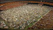 Rows of cots line the floor of the Astrodome in Houston where 15,000 Hurricane Katrina evacuees were given shelter, in this Sept. 2, 2005, file photo. Evacuees who escaped Hurricane Katrina's flooding on their own are now faring better than the thousands rescued and dumped in cities saturated with evacuees, according to a report released Monday.