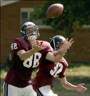 LHS's Tyler Bailey (88) follows a pass as Jessie Lopez (32) attempts to block during practice Thursday afternoon at LHS.